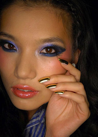 gold nail polish at baby phat spring 2010 new york fashion week Metallic luster in manicure is still Fashion